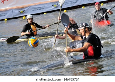 WARSAW, POLAND - JULY 16: Unidentified competitors playing the match during the final edition Polish International Kayak Polo Cup on July 16, 2011 in Warsaw, Poland.