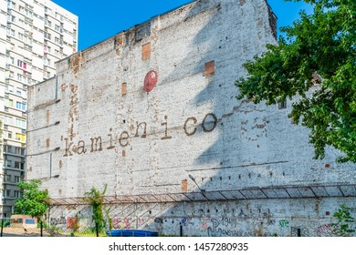 WARSAW, POLAND - JULY 18, 2019: Remains of a building in Warsaw ghetto quaters with a mural on the wall. The ruins of the building are prepered to be demolished.