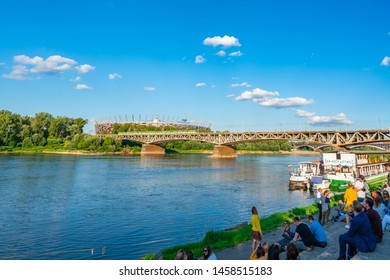 WARSAW, POLAND - JULY 18, 2019: People enjoy hot summer day on the Vistula River Boulevards, one of the most attractive and most frequented public spaces in the city.
