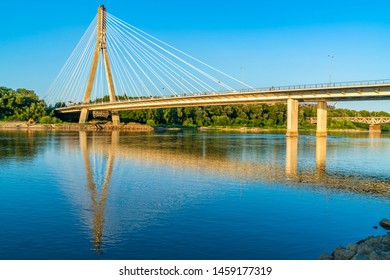 WARSAW, POLAND - JULY 18, 2019: Opened on 06/10/2000, a 479 meters long Swietokrzyski cable-stayed bridge over the Vistula river in Warsaw links Powisle neighbourhood with Praga North district