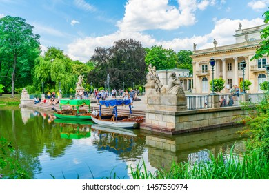 WARSAW, POLAND - JULY 19, 2019: Baths Palace or The Palace on the Isle is a classicist palace in Warsaw's Royal Baths Park, the city's largest park which occupies over 76 hectares of the city center.