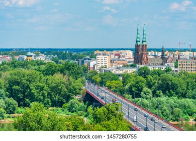 WARSAW, POLAND - JULY 19, 2019:View of Warsaw cityscape with Solidarity Avenue and St. Florian's Cathedral, symbol of the Praga North. It was built in the beginning of 20th century in Neo-Gothic style