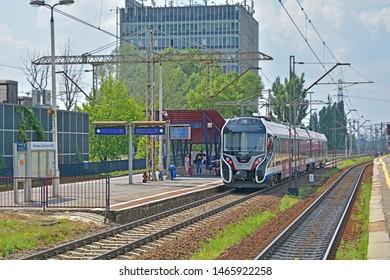 WARSAW, POLAND - JULY 20, 2019 - A Newag 39WE train, operated by Warszawska Kolej Dojazdowa (WKD), on the suburban light railway line to Warsaw, at Warszawa Zachodnia station