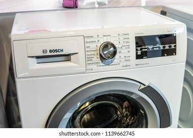 Warsaw, Poland, July 21, 2018 inside Bosch showroom, free-standing Bosch WLT24440PL Serie6 SlimLine washing machine on display Eco VarioPerfect EcoSilence Drive AquaStop A BSH Home Appliances
