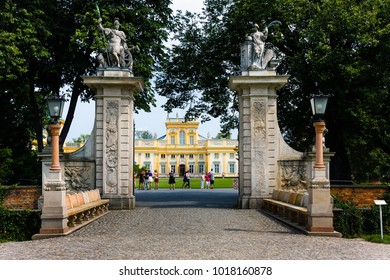 WARSAW, POLAND - JULY 26, 2014:  Tourists at the main entrance of the Wilanow Royal Palace park