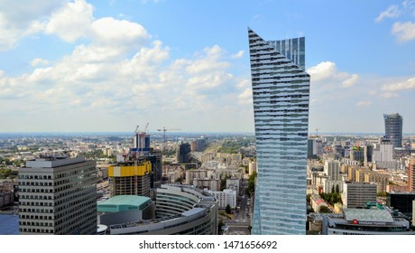 Warsaw, Poland - July 28 2019: Aerial cityscape of Warsaw city from the viewpoint / viewing tarrace located on the 30th floorof Palace of Culture and Science. Modern skycrapers at business center