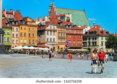 Warsaw, Poland - July 30, 2018: Tourists on Castle Square in Warsaw in Poland