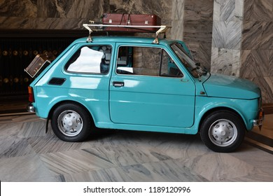 Warsaw, Poland - July 31, 2018: Vintage car Polski Fiat 126p (year 1973) with suitcases on the roof. Technical museum in the Palace of Culture and Science.