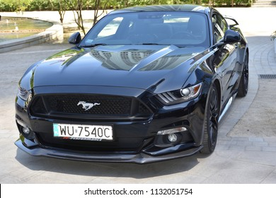 "WARSAW, POLAND - JUNE 09, 2018: Black Ford Mustang GT. Free autoshow ""Kawa i Samochody"" (Coffee and Cars) on European square, organized by DaftCafe"