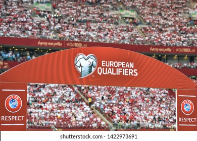 """WARSAW, POLAND - JUNE 10, 2019: Qualifications Euro 2020  match Poland - Israel 4:0. Board with with logos and subtitles """"European Qualifiers"""" and """"UEFA Respect""""."""