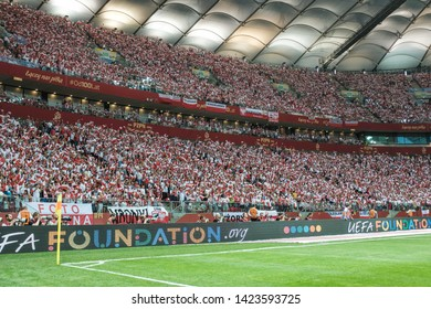 WARSAW, POLAND - JUNE 10, 2019: Qualifications Euro 2020  match Poland - Israel 4:0. Supporters of Poland with the small national flags.
