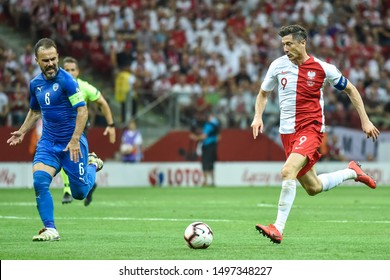 WARSAW, POLAND - JUNE 10, 2019: Qualifications Euro 2020  match Poland - Israel 4:0. In action  Bibras Natcho (L) and Robert Lewandowki (R).