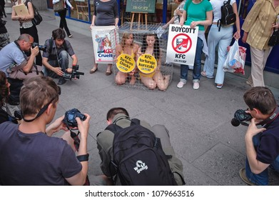 Warsaw, Poland - June 12, 2006: Activist Jodi Ruckley (L) and Karolina Kostrzewa-Colwill in a cage during a protest within PETA's Campaign Against KFC in front of KFC restaurant in Warsaw