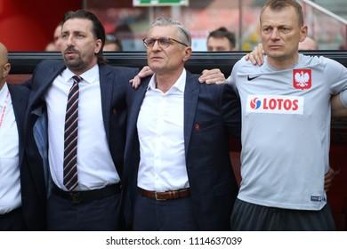 WARSAW, POLAND - JUNE 12, 2018: Friendly football game: Poland - Lithuania o/p Tomasz Iwan, Adam Nawalka, Bogdan Zajac