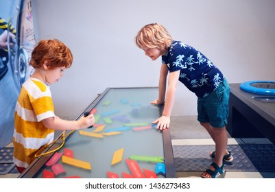 WARSAW, POLAND - June 20, 2019: Kids playing with magnetic words in the Copernicus Science Centre in Warsaw, Poland