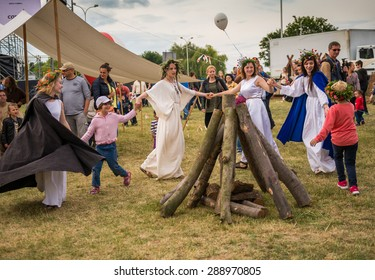 Warsaw, Poland -JUNE 20: People dance around a bonfire logs on a festival of midsommar near the old town in Warsaw, Poland June 20, 2015