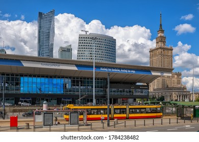 Warsaw, Poland - June 23, 2020: Warsaw Central Railway Station (Polish: Warszawa Centralna) in the city center, tram stop and Palace of Culture and Science in the background