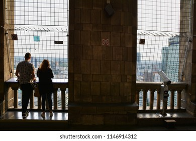WARSAW, POLAND - JUNE 27, 2018. People looking  at urban skyline with skyscrapers  ,from Palace of Culture and Science in Warsaw ,Poland.