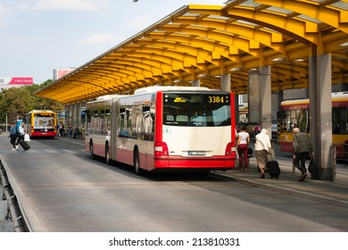 WARSAW, POLAND - JUNE 28, 2014:   Bus stops at the Warsaw Central Station (Warszawa Centralna). Tourists hurry to catch the bus