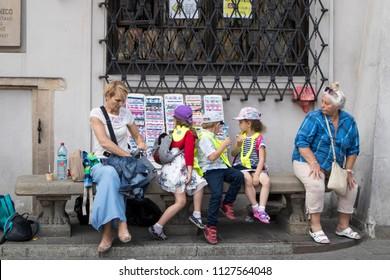 WARSAW, POLAND - JUNE 28, 2018 Children sit at the store, eat ice cream