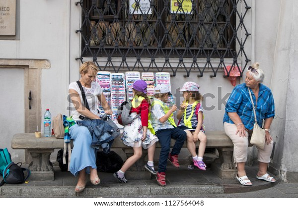 WARSAW, POLAND - JUNE 28, 2018 Children sit at the store, eat ice cream