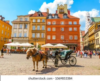 WARSAW, POLAND - JUNE 29, 2013: Warsaw Old City. Horse-drawn vehicles expect passengers in the Old Town or Stare Miasto. Warsaw, Poland