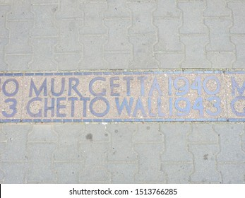 Warsaw, Poland - June 8, 2019: commemoration of the Warsaw ghetto borders, panels embedded in pavement tiles show the exact location where the ghetto's walls ran during the Nazi occupation of WWII