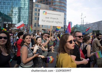 """Warsaw, Poland - June 9, 2018: Participants of large Equality Parade - LGBT community pride parade in Warsaw city. Placard """"We march for equal rights"""