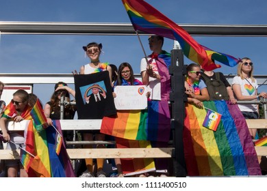 Warsaw, Poland - June 9, 2018: Participants of large Equality Parade - LGBT community pride parade in Warsaw city. Placard with Putin