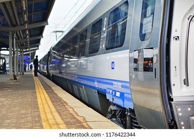 WARSAW, POLAND - MARCH 24, 2018 - Modern Pendolino train, belonging to PKP Intercity long-distance train operator, at Warszawa Zachodnia railway station
