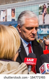 WARSAW, POLAND - MARCH 28, 2014: Jaroslaw Gowin, leader of the right-wing party Polska Razem (Poland Together) interviewed on the street during the election campaign for the European Parliament.