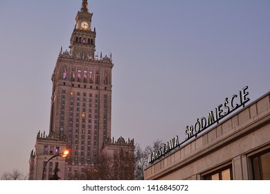 WARSAW, POLAND - MARCH 3, 2018 - Evening view of Palace of Culture and Science, and Warszawa Srodmiescie suburban railway station