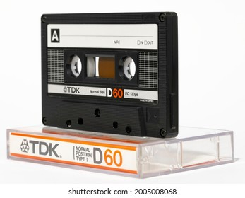 Warsaw, Poland - March 30, 2021: Compact cassette, Audio tape TDK D60. This standard of recording and reproducing sound was presented in 1963. It is also used as a data carrier.