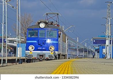 WARSAW, POLAND - MARCH 6, 2019 - PKP Intercity long-distance train, with EP07 locomotive, at Warszawa Wschodnia railway station