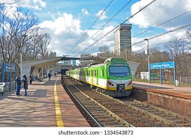 WARSAW, POLAND - MARCH 8, 2019 - Koleje Mazowieckie train at Warszawa Powisle railway station on the cross-city railway line (linia srednicowa)