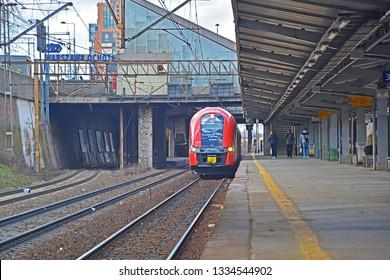 WARSAW, POLAND - MARCH 8, 2019 - SKM Warszawa city train arriving at Warszawa Ochota station on the cross-city railway line (linia srednicowa)