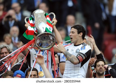 WARSAW, POLAND - MAY 02, 2015: Polish Football League Cup Final Legia Warsaw - Lech Poznan, o/p: Michal Zyro, Tomasz Jodlowiec, Ivica Vrdoljak with the cup
