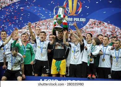 WARSAW, POLAND - MAY 02, 2015: Polish Football League Cup Final Legia Warsaw - Lech Poznan, o/p: Marek Saganowski, Michal Zyro, Dusan Kuciak, Ondrej Duda, Ivica Vrdoljak with the cup