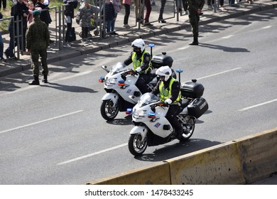 WARSAW, POLAND - MAY 03, 2019: Two police officers on motorcycles, closeup. Police escort at military parade, celebration of Polish Constitution day, 20th anniversary in NATO, 15th anniversary in EU.