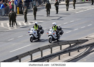 WARSAW, POLAND - MAY 03, 2019: Two police officers on motorcycles. Police escort at military parade, celebration of Polish Constitution day, 20th anniversary in NATO, 15th anniversary in EU.