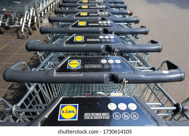 Warsaw, Poland - May 10, 2020: Row of stacked metal Lidl supermarket trolleys can be seen in perspective. This store is one of many German discount supermarket chains worldwide.