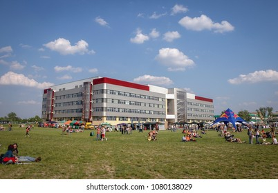 Warsaw, Poland - May 13, 2006: Students on a lawn in front of Forestry Faculty building of SGGW - Warsaw University of Life Sciences