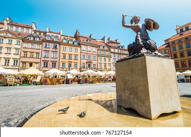 Warsaw, Poland - May 17, 2013: Panorama of Old Town Market Place in Warsaw, Poland, Europe. UNESCO World Heritage Site. Statue of Syrenka (Mermaid of Warsaw).