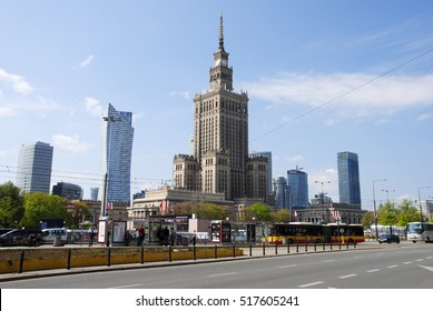 WARSAW, POLAND - MAY 2, 2016. Street view in Warsaw, with the Palace of Culture and Science, other commercial and residential buildings, people and city traffic.