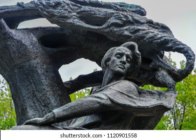 Warsaw, Poland - May 2014: The Frederic Chopin monument by sculptor Waclaw Szymanowski, Royal Lazienki Park. Bronze statue surrounded by green trees and grey skies