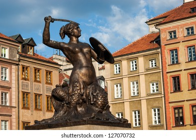 WARSAW, POLAND - MAY 26: Statue of mermaid holding sword and bucket on May 26, 2012 in Warsaw.  Mermaid (Siren) standing in Old Town is a Warsaw city symbol.