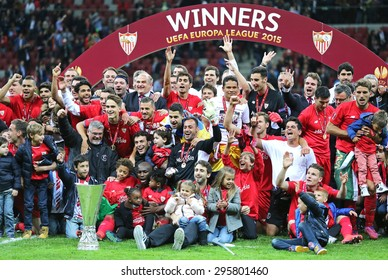 WARSAW, POLAND - MAY 27, 2015: FC Sevilla club - the Winner of the UEFA Europa League 2015 poses for a group photo with the Trophy at Warsaw National Stadium