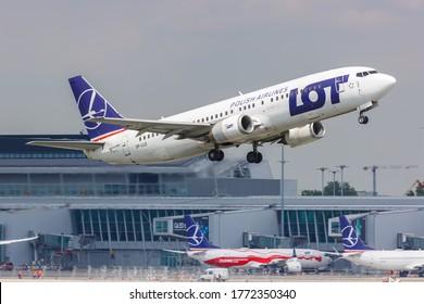 Warsaw, Poland - May 27, 2019: LOT Polskie Linie Lotnicze Boeing 737-400 airplane at Warsaw Warszawa airport (WAW) in Poland.