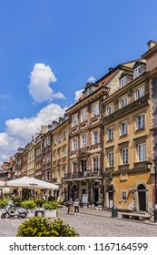 WARSAW, POLAND - MAY 28, 2016: Nice Street view of Warsaw old town: Krakowskie Przedmiescie (Krakow suburb). Warsaw is the capital and largest city of Poland.