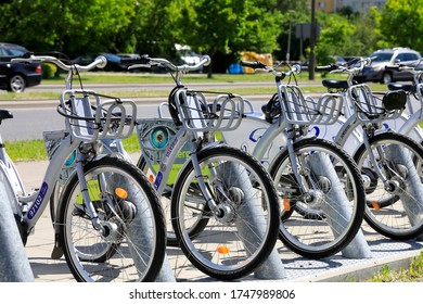 Warsaw, Poland - May 29, 2020: A row of bicycles that have been parked in a public bike station. An easily accessible bicycle, it's a great tool for environmentally friendly mobility around the city.
